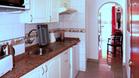Kitchen with fridge, double plate stove and extractor hood to the outside